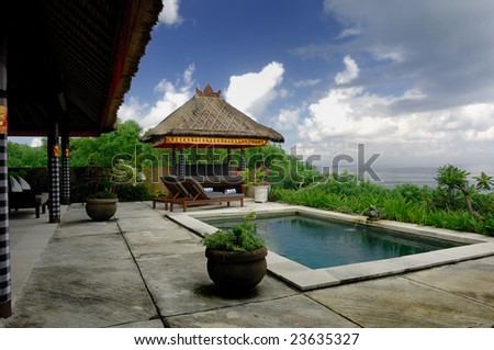 Bali Villa with swimming pool and relaxation bed.