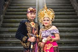 Balinese Couple Using Traditional Balinese Wedding Costume in Besakih Temple