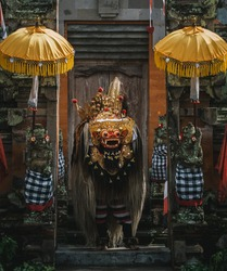 Balinese dancers in traditional costume performing on stage in the Barong dance