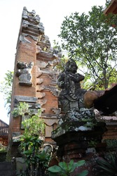 Balinese Icon Barong statue beside the gate