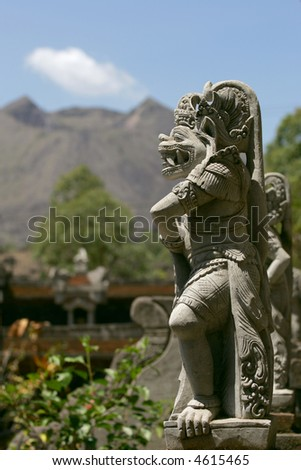 Balinese statue and volcano Bali Indonesia