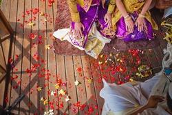 balinese wedding ceremony with sitting in the gazebo newlyweds