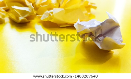 Ball crumpled paper ball isolated on a yellow background. Crumpled paper for texture. Crumpled paper after a brainstorming was thrown into the bin. A piece of yellow crumpled paper on a yellow #1488289640