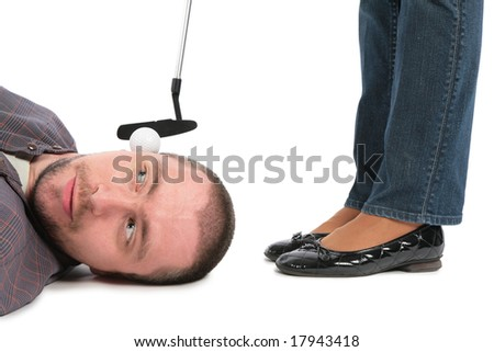 Ball for golf lies on an ear at the man