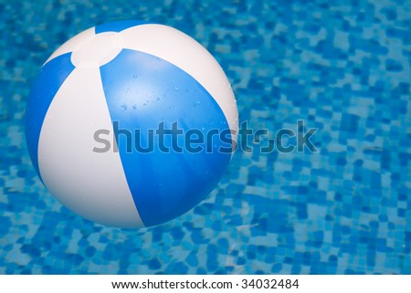 Ball in water on blue background - stock photo