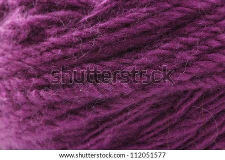 Ball of cyclamen yarn. closeup background