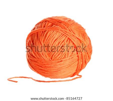 Ball of orange  yarn on white background
