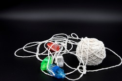 Ball of string with finger LED lights attached