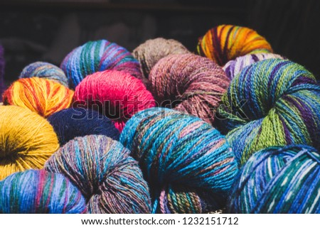 Ball of wools in different colors. Colorful wool balls in a wool store in old town. Estonian wools. Tallinn,ESTONIA.