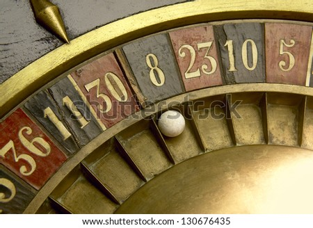 Ball on a vintage roulette with numbers