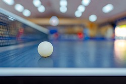 Ball on table tennis sport or ping pong on table and blurred background in activity game, net on table for competition championship