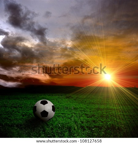 ball on the field at sunset