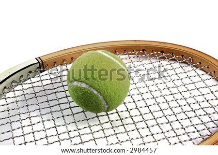 ball on top od tennis racket