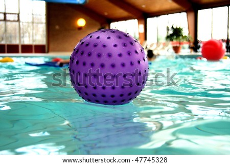 Ball on water in a swimming door