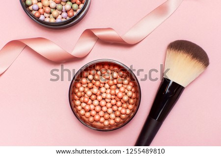Ball pearl blush, face powder, makeup brush and pink ribbon on a pastel pink background top view Flat Lay with copy space. Various cosmetic products, Makeup Accessories.  #1255489810