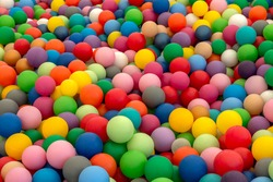 Ball Pit Pool with rainbow colors plastic balls for children to play. Dry pool