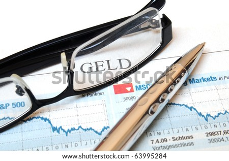 Ball point and glasses on top of a chart report