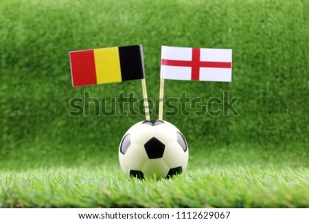 ball with Belgium VS England flag match on Green grass football 2018 #1112629067