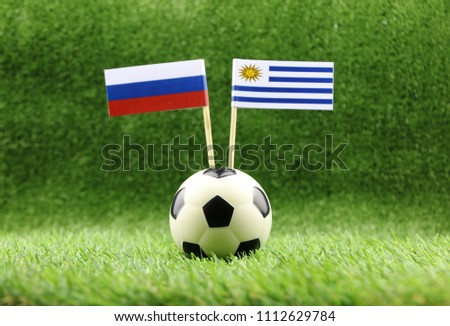 ball with Uruguay VS Russia flag match on Green grass football 2018 #1112629784