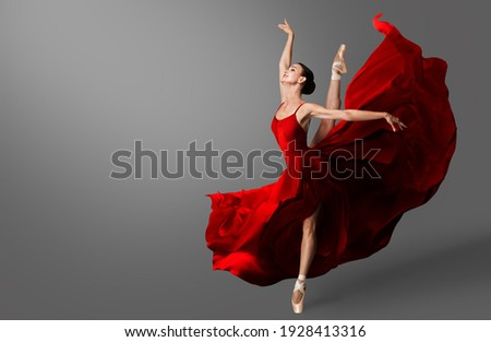 Ballerina Dance. Ballet Dancer in Red Dress jumping Spit. Woman in Ballerina Shoes dancing in Evening Silk Gown flying on Wind Foto d'archivio ©