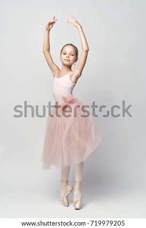 ballerina dances on a bright background in full growth in the studio, sketchy dance, costume, ballet, art                                #719979205
