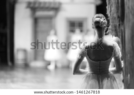 Ballerina in costume and pointe is standing backstage during the intermission of the performance Stock photo ©
