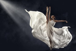 Ballerina Jumping in White Silk Dress, Modern Ballet Dancer in Pointe Shoes, Fluttering Waving Cloth, Gray Background