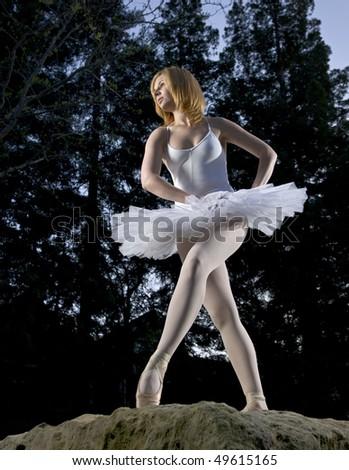 Ballerina poised on granite stone
