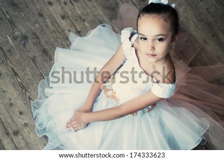 Ballet, ballerina - young and beautiful ballet dancer in tutu in dance studio. Art photo.