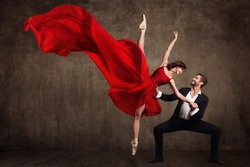 Ballet Couple Dance, Beautiful Woman in Red Dress and Man in Suit, Ballerina in Fluttering Flying Fabric