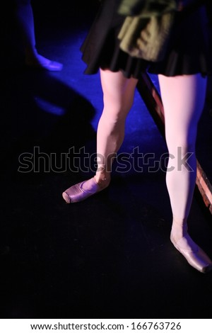 Ballet dancer legs on the stage