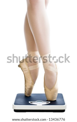ballet dancer standing on the bathroom scales