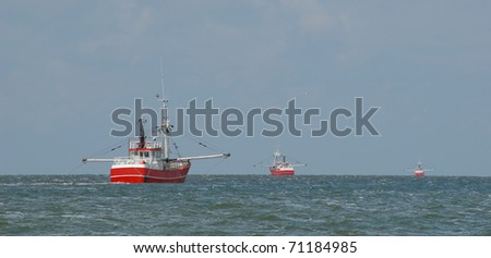 Ballet of trawlers - Fishing boats pull the trawls near the Danish island of Romo.