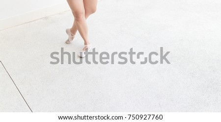 ballet right foot stand and left foot point position on the street with point shoes #750927760
