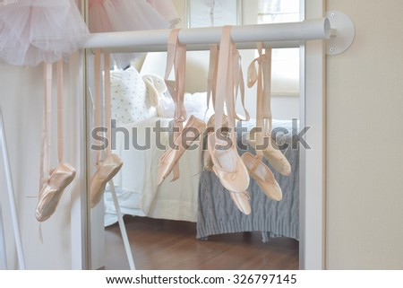 a681658260c5 ballet shoes hang on bar in bedroom #326797145 · Ballet dress and pointe ...