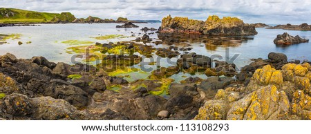 Ballintoy bay in Northern Ireland small basalt isles and rock formations of various kinds rise out of the atlantic ocean