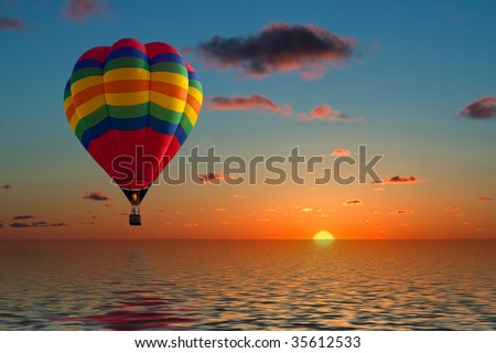 Stock Photo balloon flying into sunset over water