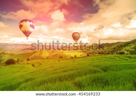 Balloon flying on rice field, Rice field in mountain or rice terrace in the nature, Relax day in beautiful location, rice field in the mountain and travel place for relax and feeling nice - Shutterstock ID 454169233