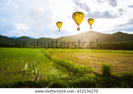 Balloon flying over rice field ,morning - Shutterstock ID 422536270