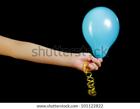 balloon in his hand on a black background