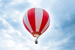 Balloon in the blue sky. Red balloon in the blue cloudy sky.