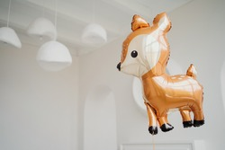 balloon in the form of an animal deer, a festive decoration . flies in the apartment alone