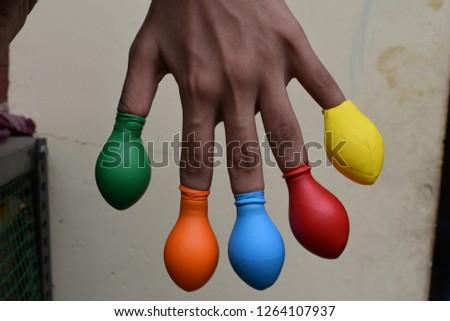 Balloon on finger or kids wearing balloon on fingers  #1264107937