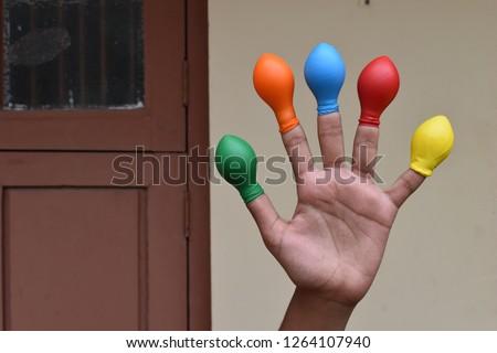 Balloon on finger or kids wearing balloon on fingers  #1264107940