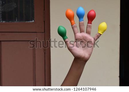 Balloon on finger or kids wearing balloon on fingers  #1264107946
