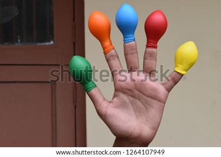 Balloon on finger or kids wearing balloon on fingers  #1264107949