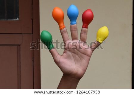 Balloon on finger or kids wearing balloon on fingers  #1264107958