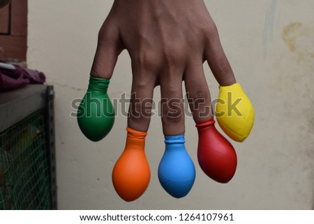 Balloon on finger or kids wearing balloon on fingers  #1264107961