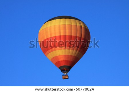 Balloon rising on a clear morning