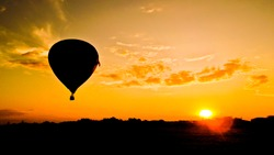 balloon silhouette with sunrise